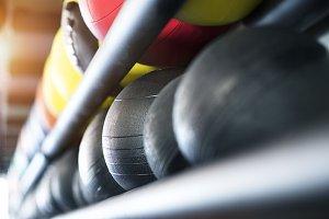 Medicine balls on shelf in modern gym.