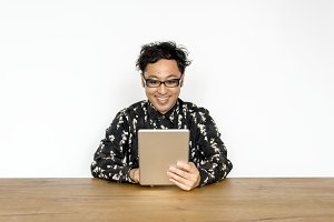 Asian guy using digital tablet
