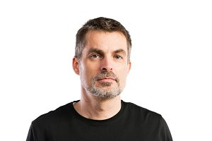 Mature hipster man in black t-shirt. Studio shot, isolated.