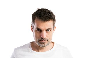 Mature hipster man in white t-shirt. Studio shot, isolated.