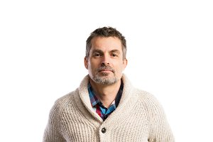 Mature hipster man in beige sweater. Studio shot, isolated.
