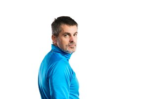 Mature hipster man in blue sweatshirt. Studio shot, isolated.