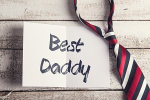 Colorful tie and Best daddy sign. Fathers day. Studio shot.