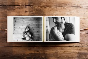 Photo album with pictures of father and baby girl. Fathers day.