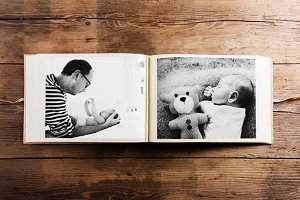 Photo album with pictures of father and baby son. Fathers day.