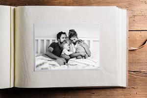 Photo album with picture of young family. Fathers day.
