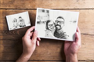 Pictures of father and daughter, wooden background. Fathers day.