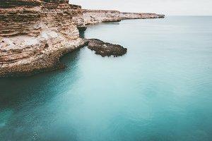 Blue Sea with rocky seaside