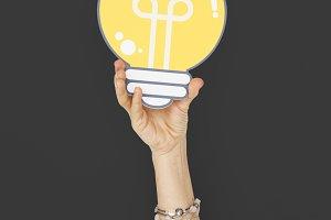 Human Hand Holding Lightbulb