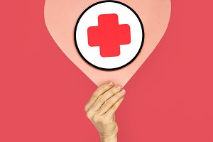 Human Hand Holding Heart Red Cross