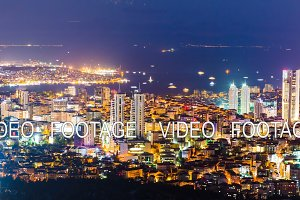 Rooftop timelapse of Bosphorus and Istanbul cityscape with floating boats and Golden horn at night