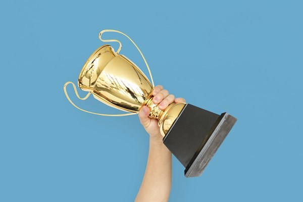 Hand holding Prize Trophy