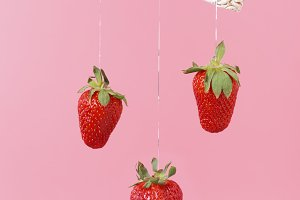 strawberries on a pink background