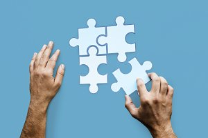 Hands Jigsaw Puzzle Together