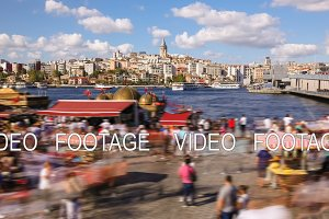 Timelapse of people walking around famoust tourist place in Istanbul with Galata Tower view and Bosphorus