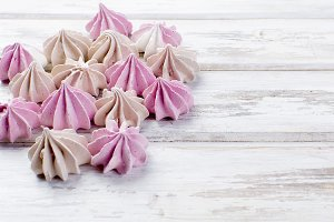 Pink and beige colored meringues