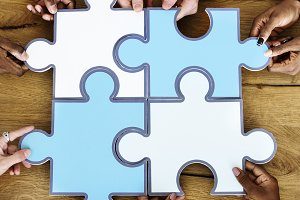 People Jigsaw Puzzle Together