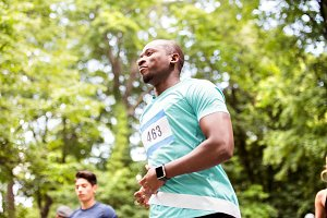 Young fit afro-american man crossing the finish line.