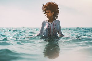 Beautiful girl standing in water