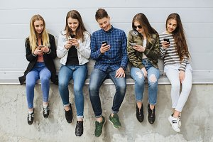 Teenagers with smartphones