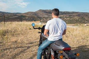 Man on motorbike in mountains