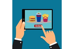 Hand holding tablet, order fast food