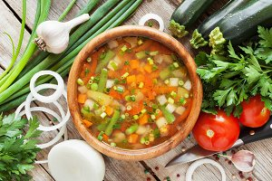 Vegetable soup in wooden bowl