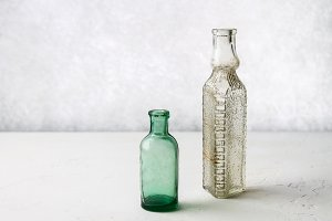 vintage glass bottles on a light background