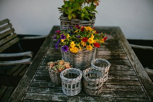 Basket with flowers on a wooden table