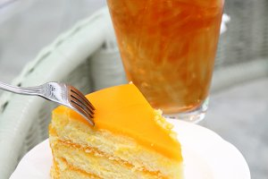 Delicious orange cake with iced tea