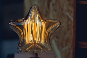 Vintage star shaped lamp. New Year's concept.