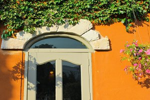 Window italian style with plant