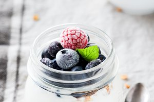 Yogurt with blueberries and raspberries in a jar