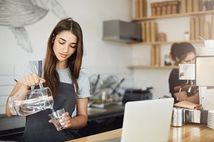Female barista pouring water to better taste coffee nuances