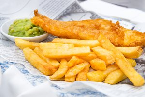 Fish and Chips with mushy peas served in the Pub