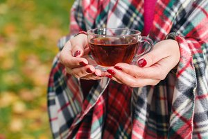 Female in plaid drink tea