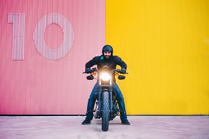Man poses on motorcycle