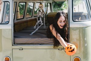 girl in the van with pumpkin