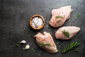 Raw chicken fillet with spices.