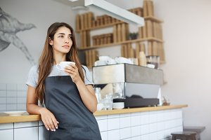 Shop owner having a break from her work as a barista dreaming of bigger business