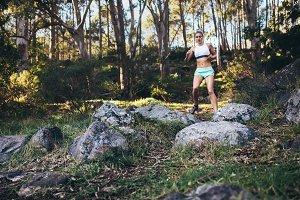 Athlete jogging in forrest