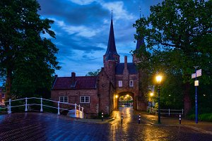 Oostport (Eastern Gate) of Delft at night. Delft, Netherlands