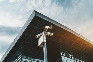 Three security cameras on pillar