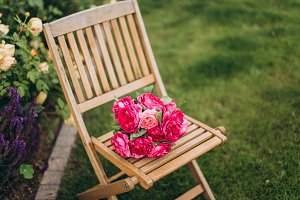 Beautiful bouquet of roses on chair