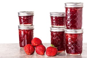 Strawberries and jam in jars