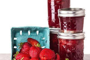 Jars of jam and strawberries