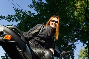 Adult Woman Riding Her Motorcycle