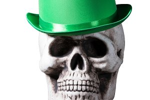 Isolated skull with green hat