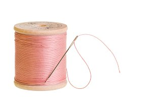 Spool of pink thread isolated