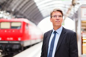 Businessman In Train Station